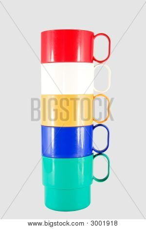 Stack Of Plastic Mugs In Various Colors
