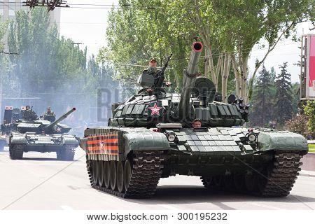 Donetsk, Donetsk People Republic, Ukraine - May 9, 2019: Armored Soviet Tanks T-72 Driving Through T