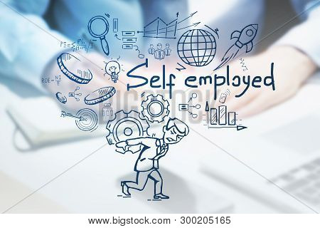 Blurred Hands Of Businessman Writing At Office Table With Computer With Double Exposure Of Self Empl