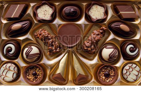 Variety Of Chocolate Candies. Luxurious Box Of Chocolates.decorated Chocolate Candies, Bitter And Wh
