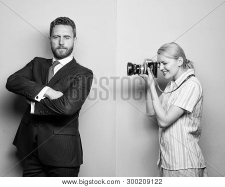 Paparazzi concept. Photosession for business magazine. Handsome businessman posing camera. Nice shot. Fame and success. Photographer taking photo successful businessman. Businessman enjoy star moment poster