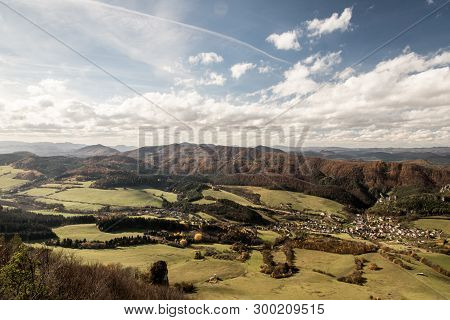 Beautiful Landscape Scenery With Meadows, Sulov Village And Hills Covered By Colorful Forest From Ke
