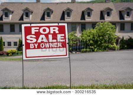 Blank For Sale By Owner Sign In Front Of A Row Of Town Houses Or Homes In The Usa