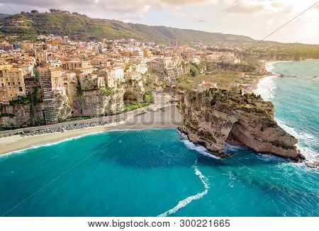 Panorama With Beautiful Italian Town Tropea, In South Of Italy With The Iconic Beach, Old Town And C