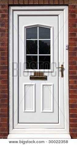 white front door in a red brick  building,uk