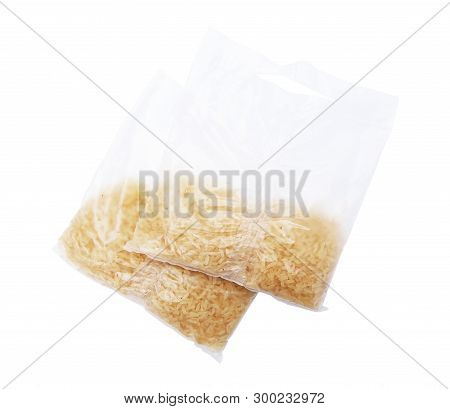 Rice In Bags Isolated On The White Background