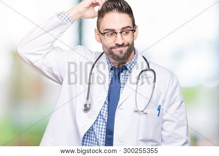 Handsome young doctor man over isolated background confuse and wonder about question. Uncertain with doubt, thinking with hand on head. Pensive concept.
