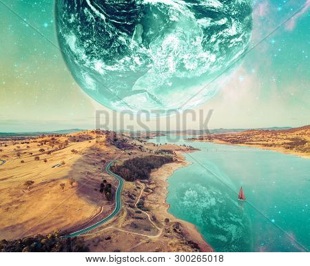 Unreal Fantasy Landscape Of Sailboat Sailing Across A River On Alien Planet. Elements Of This Image