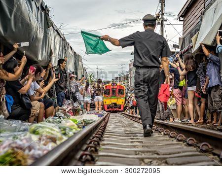 Mae Klong, Thailand - May 14, 2017: Maeklong Railway Market (talad Rom Hub). Train Passing Through L