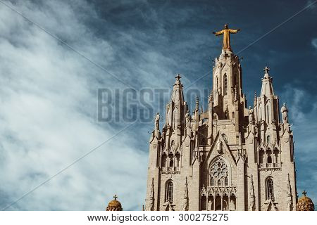 Sculpture of the Sacred Heart of Jesus on the Sagrat Cor church in Tibidabo mountain over Barcelona, Spain poster