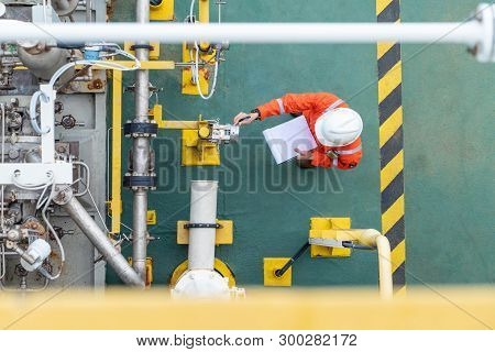 Oil And Gas Industry Activity, Operator Check And Inspect Oil Pump Differential Gauge And Pressure T