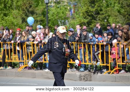 Omsk, Russia - May 9: War Veteran Marching On Parade Dedicated To Victory Day, The City Of Omsk, Sib