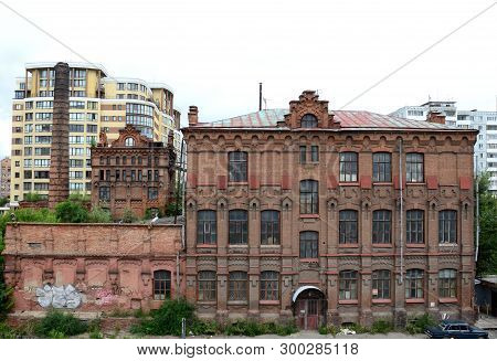 Omsk, Russia - August 7, 2016: A View Of The Old Building Wine Warehouses Built In 1901, Omsk, Russi