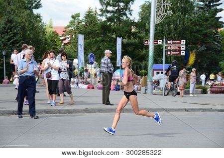 Omsk, Russia - August 7: Marathon Runners In Action At The Siberian International Marathon On August