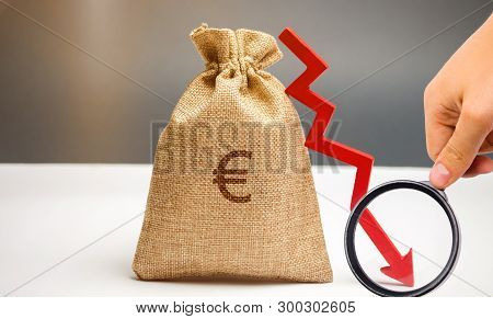 Money Bag With A Euro Sign And An Arrow Down. The Concept Of Reducing Profits. Drop In Revenue. Low