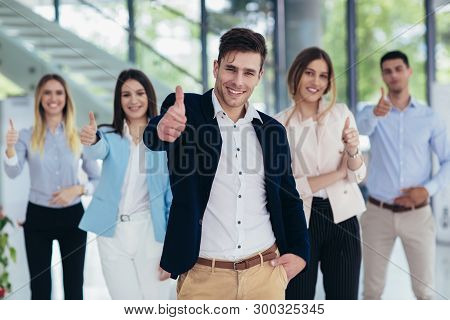 Group Of Happy Business People And Company Staff In Modern Office, Representig Company