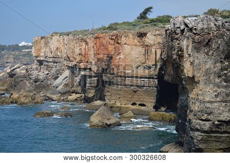 Majestic Cliff And Geological Formation Of The Grotto Of The Mouth Of Hell In Cascais. Photograph Of