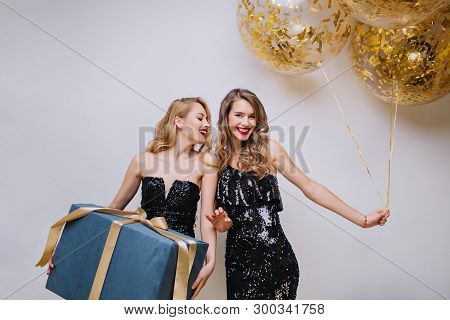 Attractive Ypung Women In Black Luxury Dresses Celebrating Birthday Party With Big Present And Ballo