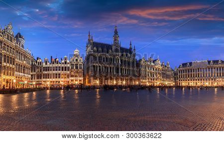 Grand Place Square In Brussels With Night Lighting, Illuminated Facades, Belgium. The Main Attractio
