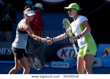 MELBOURNE - JANUARY 27: Svetlana Kuznetsova (R) and Vera Zvonareva of Russia winning the doubles championship at the 2012 Australian Open on January 27, 2012 in Melbourne, Australia.