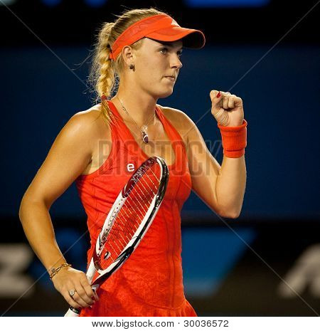 MELBOURNE - JANUARY 22: Caroline Wozniacki of Denmark in her foruth round win over Jelena Jankovic of Serbia at the 2012 Australian Open on January 22, 2012 in Melbourne, Australia.