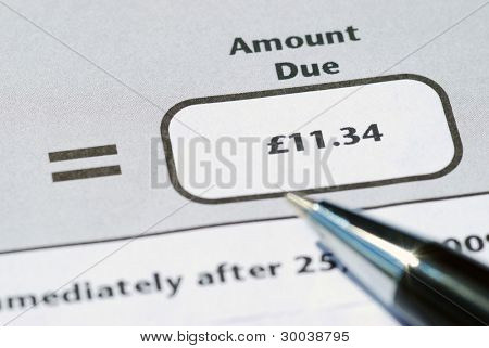 Closeup of pen resting on a bank statement poster
