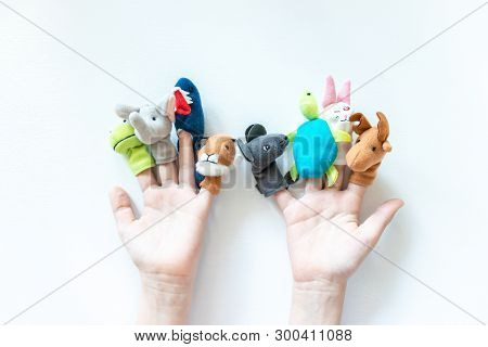 Hands Of A Child With Finger Puppets, Toys, Dolls Close Up On White Background - Playing Puppet Thea
