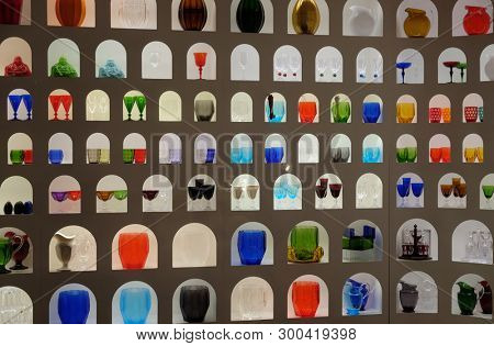 FLORENCE, ITALY - JANUARY 11, 2019: Imaginative display of bright colourful glasswork in a craft and design shop in Florence, Tuscany, Italy
