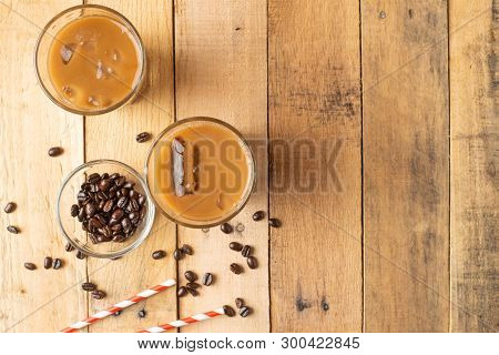 Flat Lay. Cold Coffee In Transparent Glasses With Ice And Straws, On A Wooden Background, Cooling Dr