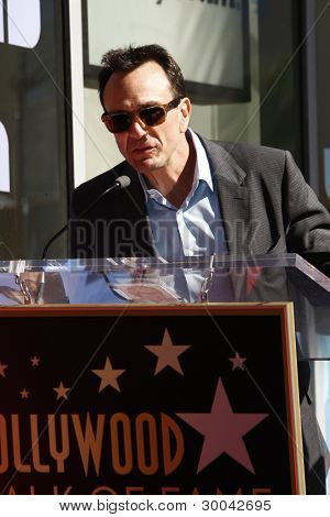 LOS ANGELES, CA - FEB 14: Hank Azaria at a ceremony as Matt Groening receives a star on the Hollywood Walk Of Fame on February 14, 2012 in Los Angeles, California