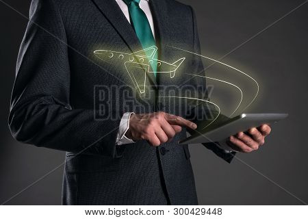 Airplane Travel. Travel Agent. Businessman Is Buying Online A Ticket To A Plane Via Internet On His