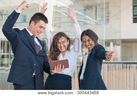 Three Good Looking Colleagues Standing  In Office Corridor, Exulting, Receiving Good News, Gesticula
