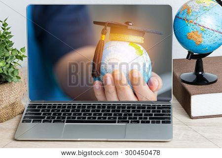 Business Online Education Concept: Educational In Global World, Graduation Cap On Businessman Holdin