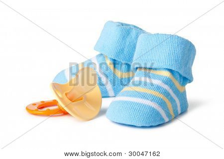 Blue baby socks and pacifier on a wihite background