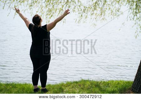 Body Positive, Success, Freedom, Happiness, Confidence, Self Esteem. Overweight Woman Rising Hands T