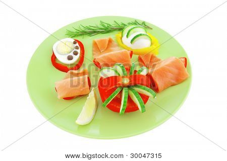 salmon on green dish with boiled eggs