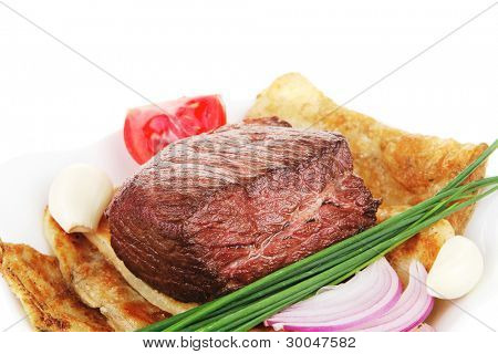 grilled meat : beef ( pork ) garnished with tomatoes salad in bowl , green chives isolated over white background