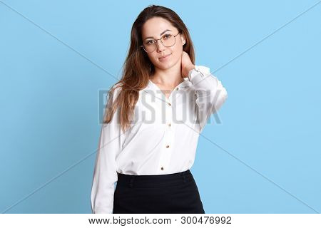 Portrait Of Young Businesswoman Having Pain In Her Neck, Being In Office, Takes Break, Wants To Rela