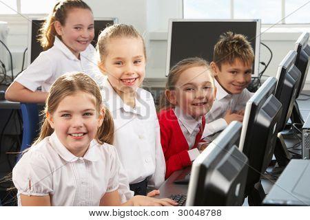Children using computers in school class