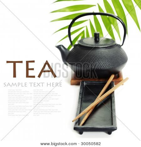 Asian food concept (Tea pot and chopsticks) with sample text