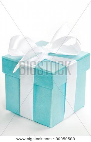 Single blue gift box with white ribbon on white background.