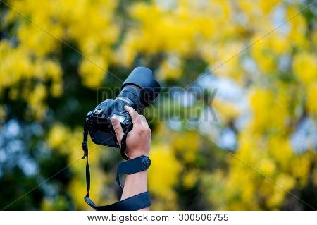 Hand Photograph And Photographic Equipment Of The Photographer Concept Photographer