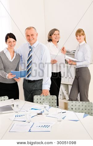 Sales meeting business people review reports consulting new strategy