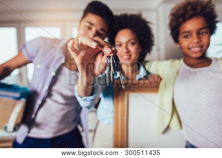 The African American Family Is Moving Into A New Apartment, They Keep The Keys From The Apartment In