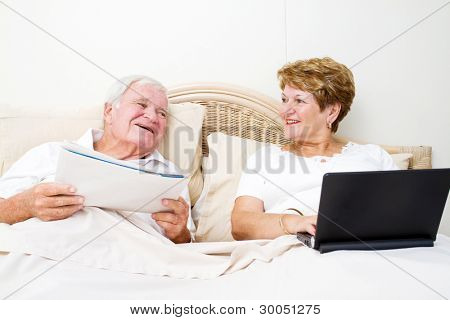 senior couple chatting in bed before sleep