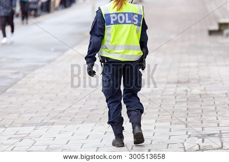 Female Police Officers Back With Reflective Vest