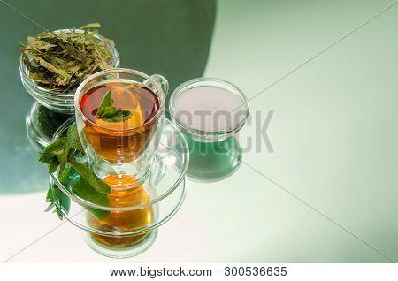 Stevia Dry Leaves And Stevia Sweetener On Mirror Background. Stevia Have Stevioside (steviol Glycosi