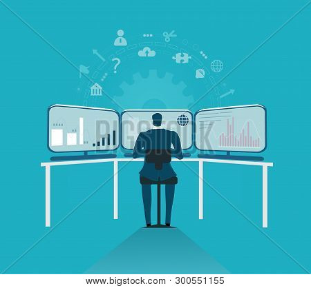Businessman Working With Three Computer Screens, Monitoring The Finance Market And Making Decisions.