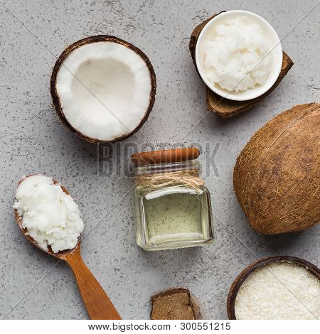 Fresh Chopped Coconut, Coco Flesh And Jar With Coconut Oil On Concrete Background, Top View. Extra V
