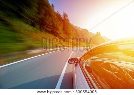 Car In Motion Blur Driving In The Italian Mountains